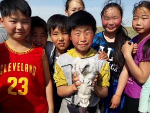 kids holding falcon